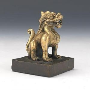 Chinese School -  Fully Sculpted Cast Gilt Bronze Sitting Dragon